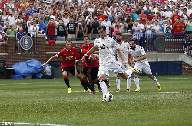 Cool customer: The former Spurs man made no mistake with his penalty that brought Madrid level
