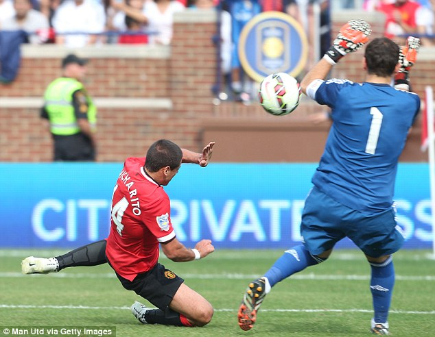 Heading home: Javier Hernandez beats Casillas to the ball to make it 3-1 to United at the Michigan Stadium