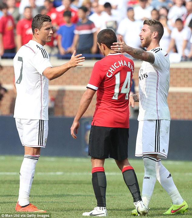 Respect: Ronaldo and Sergio Ramos congratulate Hernandez after his goal in the closing stages for United