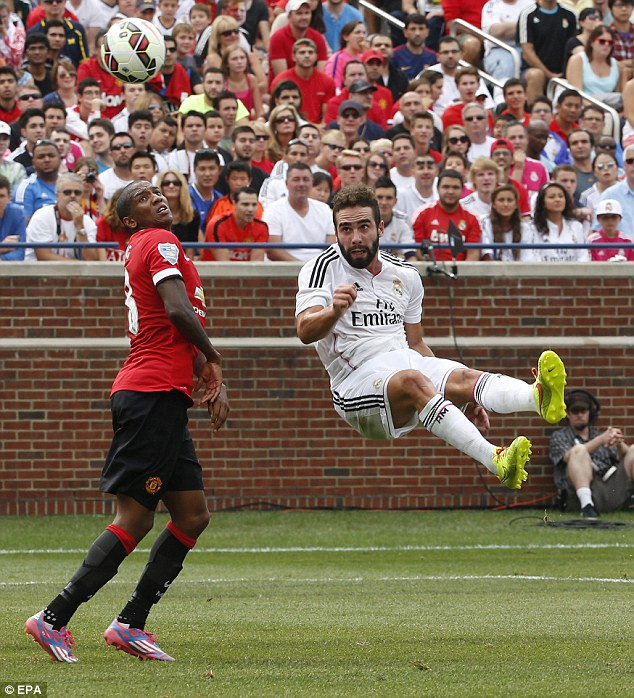 In flight: Dani Carvajal heads the ball to a team-mate after wanting it more than his opponent Young