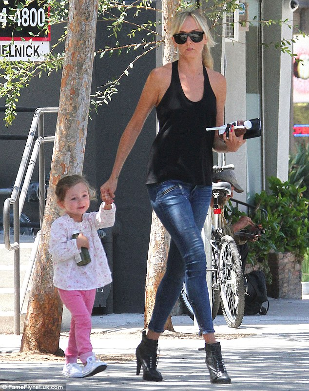 She previously said: 'Benicio's very involved; he and Delilah have a very special bond. She definitely looks like her dad, but she has my legs and eye colour'
