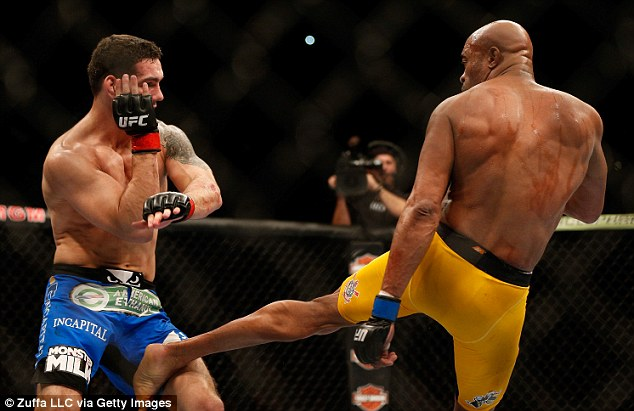 UFC fighter Anderson Silva (yellow trunks) experienced a similarly horrific break in a middleweight championship fight last year