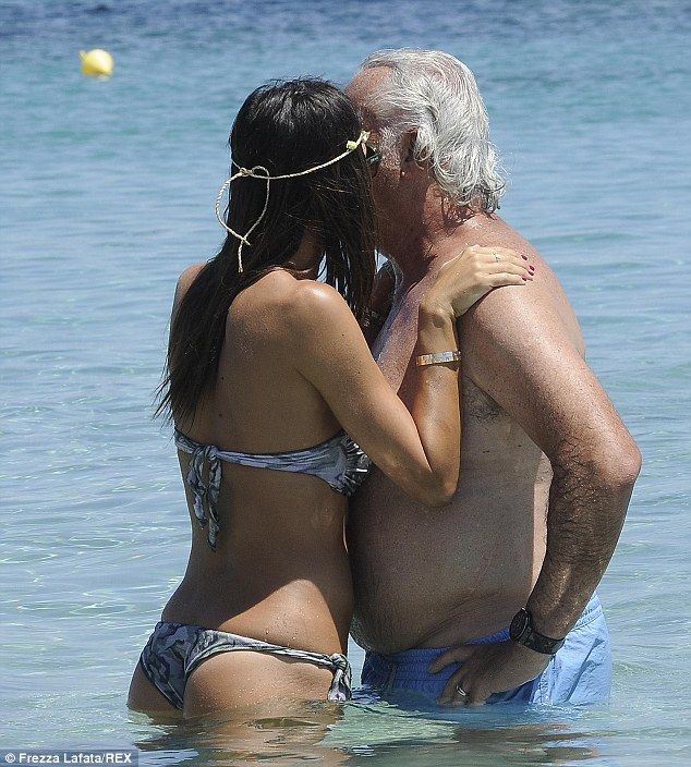 Pucker up: Elisabetta Gregoraci kissed husband Flavio Briatore as they soaked up the sun in Porto Cervo, Sardinia on Friday