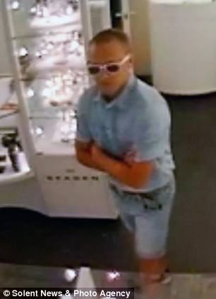 The man was wearing a blue shirt, jean shorts and Rayban sunglasses when he walked into the store in Eastleigh, Hampshire