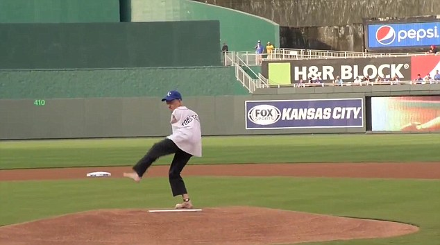 Winding it up: Willis gets prepared to throw the ceremonial first ball in Kansas