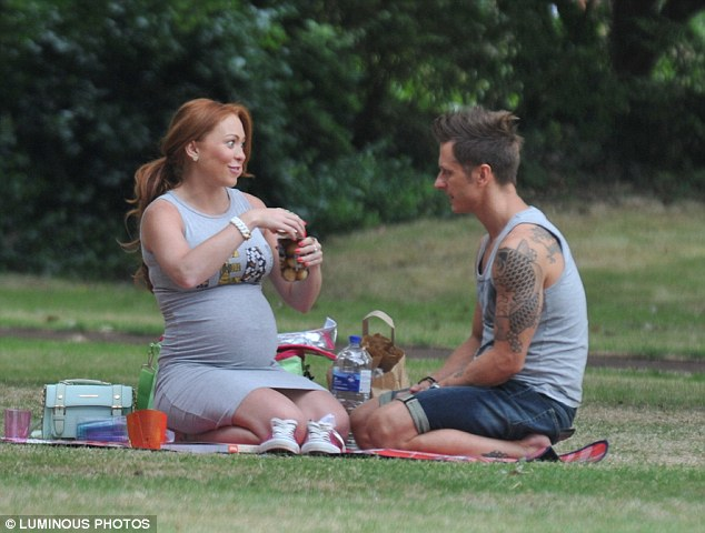 Pregnancy cravings? The pregnant Atomic Kitten star was seen tucking into a jar of pickled onions as he man watched on