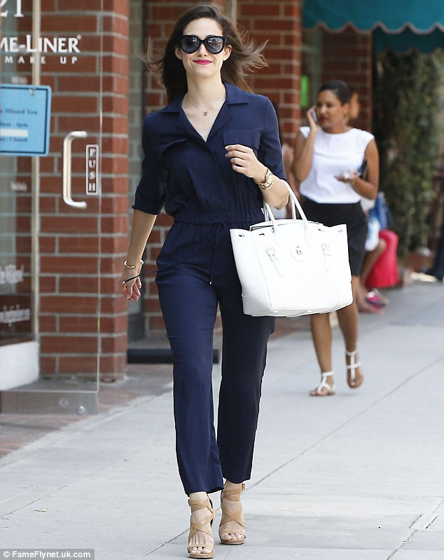 Sidewalk strut: Emmy Rossum looked chic when she headed out shopping in Beverly Hills, California on Friday