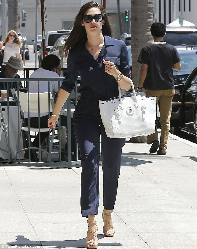 Cool and casual: The actress left her long, brunette tresses down while keeping her glamourous shades firmly on