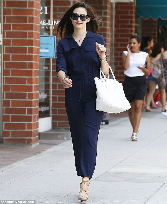 Breezing by: The Shameless regular polished off her outfit with a large, white handbag and a chunky gold watch