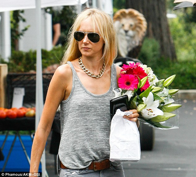 Casual but stylish: The 34-year-old daughter of rocker Rod Stewart looked effortlessly chic in gray skinny jeans, a heather gray tank top, brown heeled booties, a chunky gold necklace and aviator sunglasses