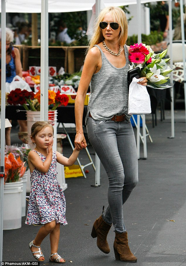 Mommy-daughter date: Kimberly Stewart brought along her best shopping buddy - three-year-old daughter Delilah - to pick up some fresh flowers at the Beverly Hills farmer's market on Saturday