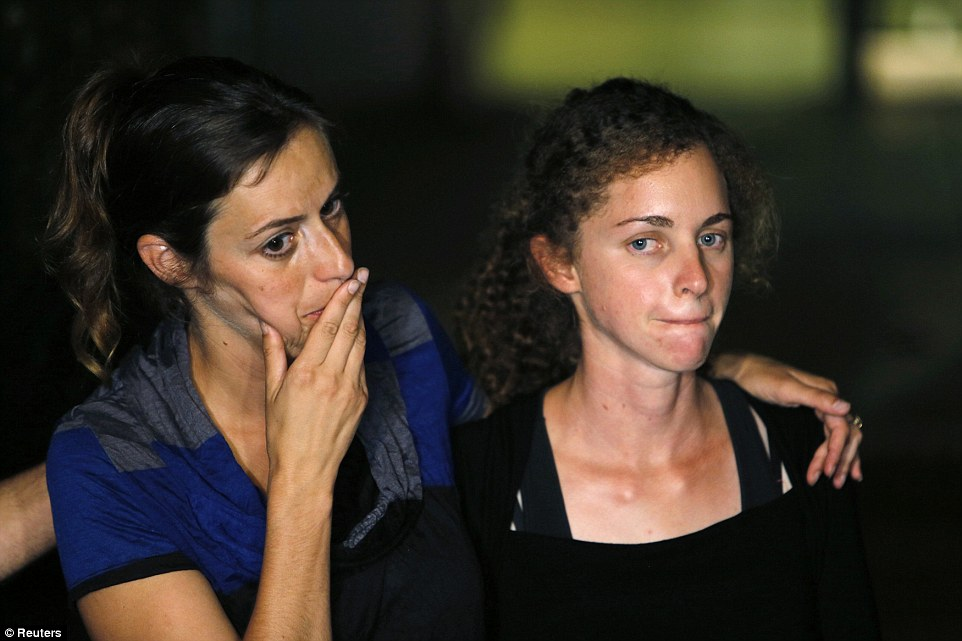 Mourning: Lieutenant Goldin's sister, Ayelet, left, and his fiancée Edna, right, are seen with tears in their eyes after the announcement was made