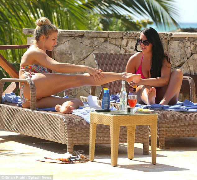 Rub it in:Gemma was sure to protect her skin as she rubbed sunscreen lotion over her svelte physique