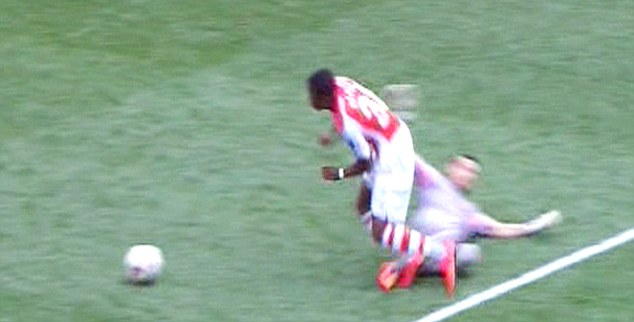Contact: Danijel Subasic clearly brings down Chuba Akpom inside the penalty box