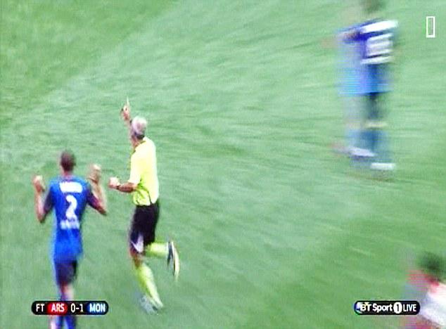 Instincts: Referee Martin Atkinson points the spot after Chuba Akpom is fouled by Danijel Subasic
