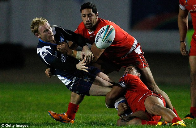 Crunch: Peter Wallace of Scotland is tackled by Brent Kite and Nafe Seluini (right) of Tonga
