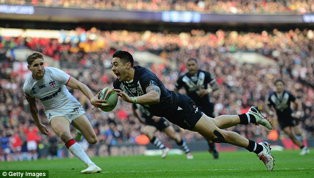 Heartbreak: Shaun Johnson scores the winning try for New Zealand against England at the 2013 World Cup