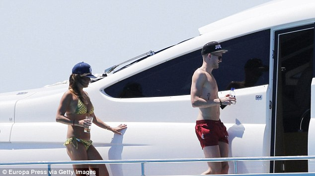 Time off: Andre Schurrle was pictured last month on holiday in Ibiza with girlfriend Montana Yorke