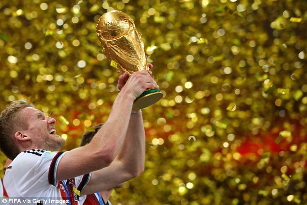 Golden moment: Andre Schurrle celebrates winning the World Cup with Germany
