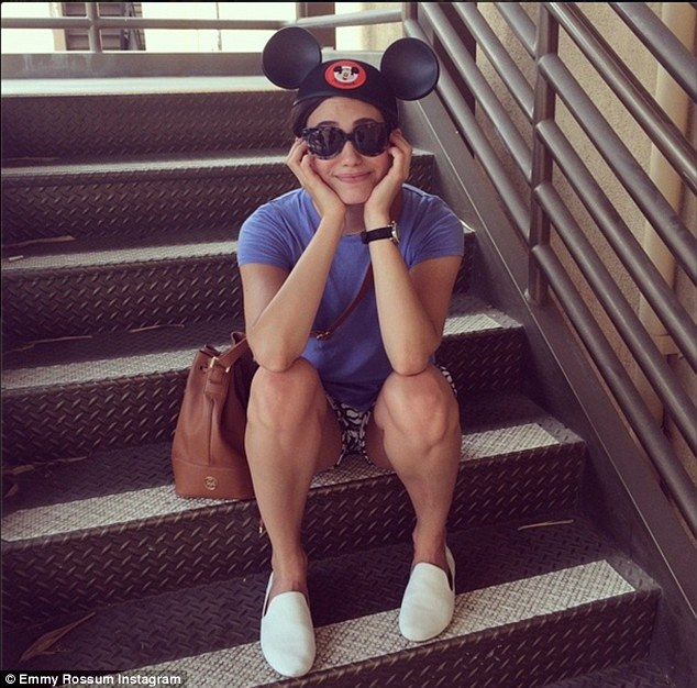 Happiest place: Emmy Rossum posts a couple of Instagrams from Disneyland. This one she is wearing mouse ears, posting 'I think I feel more me with the ears than without'