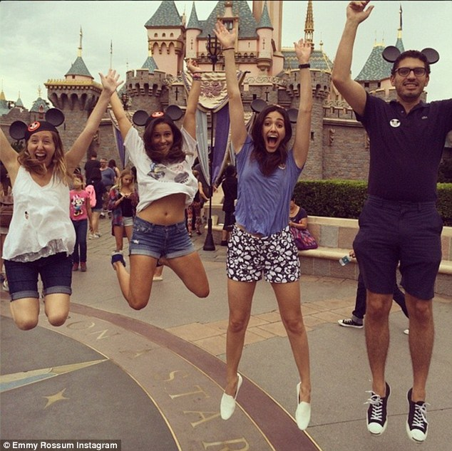 Yipeee! Another photo shows Emmy, her boyfriend Sam Esmail and two pals jumping up in front of the enchanted castle, writing 'This is when we found out they serve alcohol at #CaliforniaAdventure!!!'