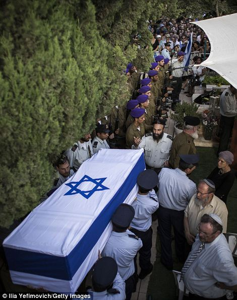 An honor guard caries the coffin of  Lt Goldin during his funeral in Kfar-saba, Israel