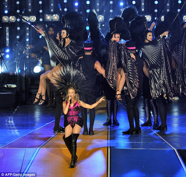 High drama: The epic performance saw two outfit changes and seven songs as she closed the sporting event