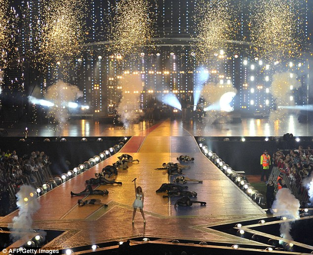 Grand spectacle: After switching to a cream and gold number for the final songs, the pop star concluded the show in grand fashion