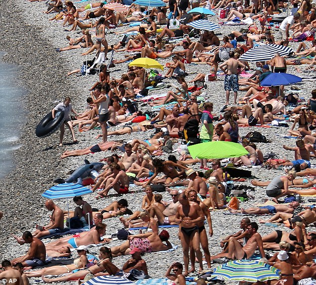 Busy beach: The pebbles in Nice are being steadily eroded by the Mediterranean sea