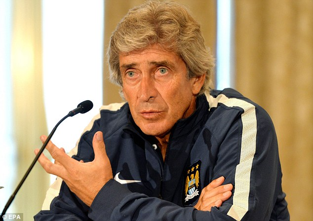Champion: Manuel Pellegrini won the Premier League and Capital One Cup in his first season in England