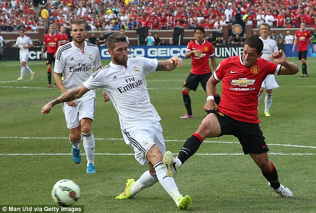 Tackle: Javier Hernandez and Sergio Ramos compete for the ball in the International Champions Cup