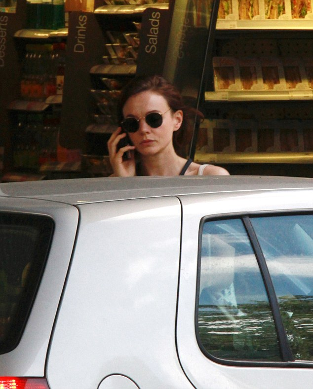 In demand: The pretty star took time to stop what she was doing to take a phonecall