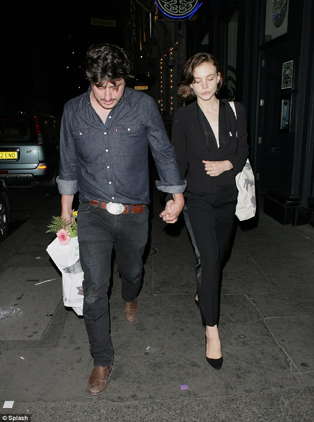 Rarely seen out: Carey Mulligan and husband Marcus Mumford seen out and about in London on Wednesday night
