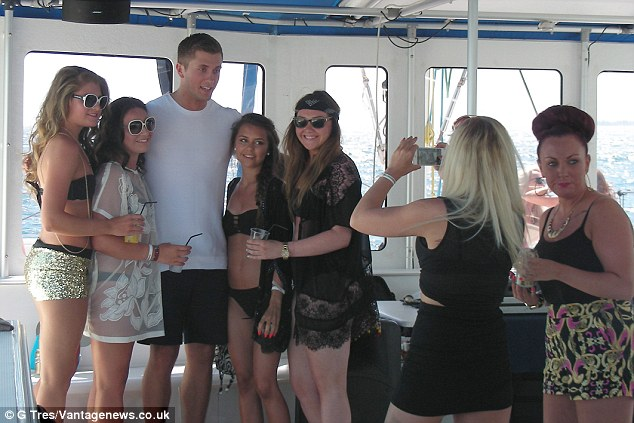 Lads: The reality star was enjoyingt a break with his mates and seemed to be having a raucous time of it