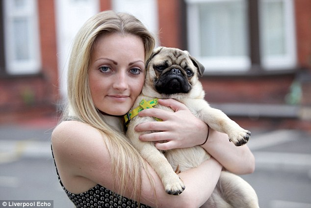 Safe: Trainee beautician Maria Smith cuddles Simba, her pet dog, who she was only able to get back from ruthless dognappers who threatened to slice him up after Facebook detective work led her to the culprits