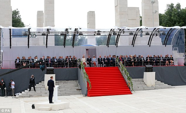 Addressing the crowd: William, bottom left at the podium, spoke to an influential audience including the French and German presidents and the royal family of Belgium