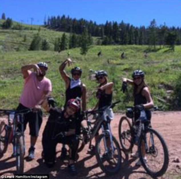 Posing up a storm: The couple were joined by some friends for the challenging bike ride