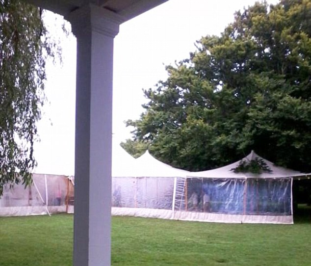 EXCLUSIVE: A view from inside the compound of the tents on Saturday, taken from the porch