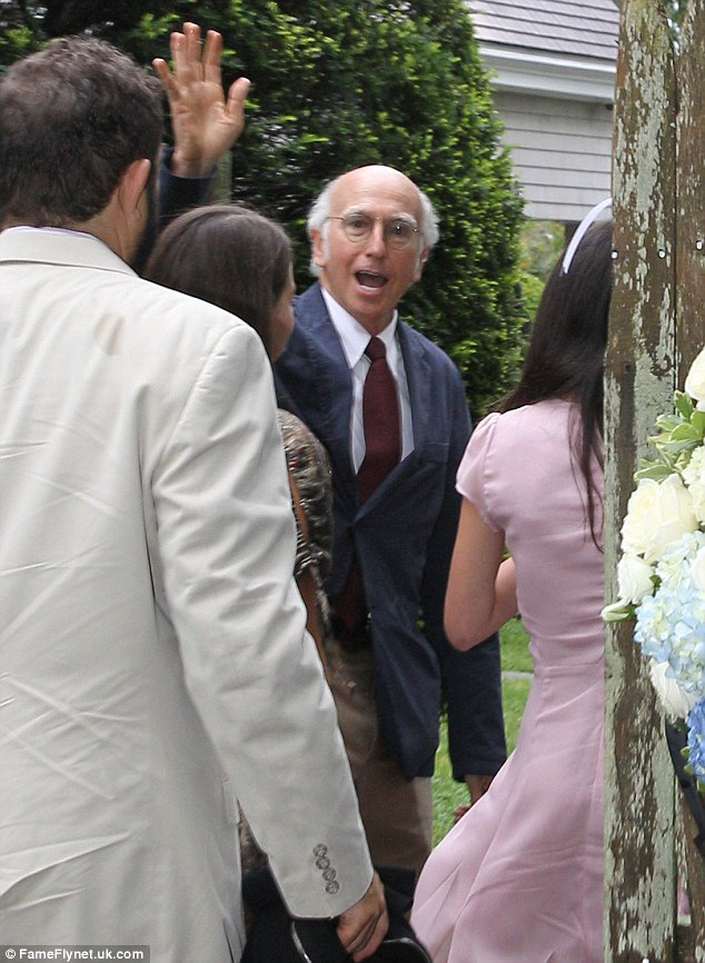 Hi there! Larry David, Cheryl Hines' co-star on HBO's Curb Your Enthusiasm offers a big wave to the camera. He reportedly declined the opportunity to give a toast at the reception