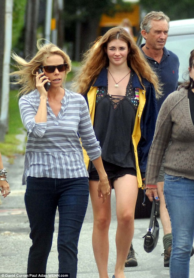 Post-wedding trip: Cheryl Hines (left) and new husband Robert F Kennedy Jr (right) went out for a boat ride with friends and family on Sunday, the day after they tied the knot in Hyannis Port, Massachusetts. Pictured above with an unidentified friend or family member (center)
