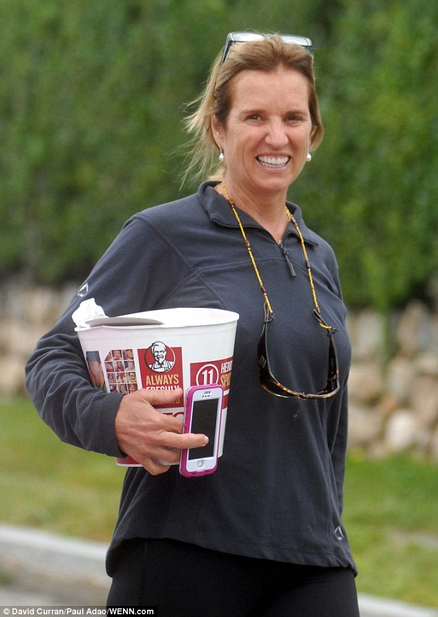 Family time: Bobby's sister Kerry Kennedy smiles as she brings a bucket of KFC fried chicken onto the boat for the excursion. Kerry and Bobby are the children of the late senator Robert F Kennedy and nephew and niece to assassinated president John F Kennedy