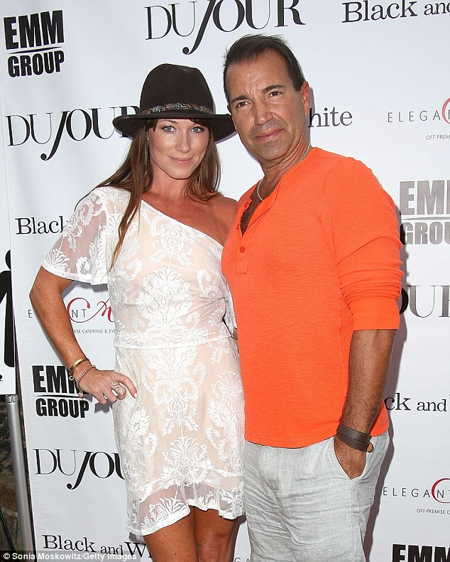 Tan duo: Presenter Jane Notar paired a trilby hat with a white one-shouldered mini-dress and her restauranteur husband Richie Notar stood out in a bright orange henley top