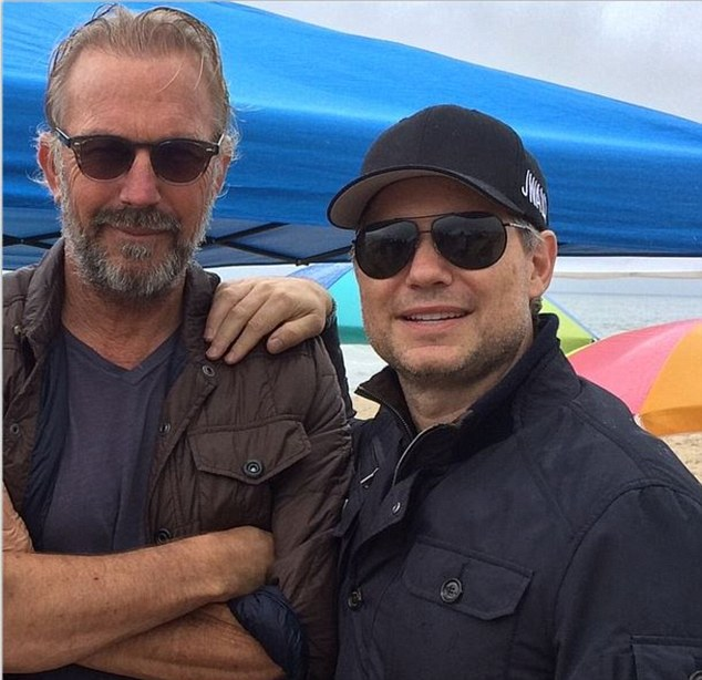 Longtime pals: Kevin Costner and Jason Binn of DuJour Media in East Hampton at the weekend. Costner stayed at Binn's home ahead of his movie premiere - while his wife Christine stayed at home to look after their three young children