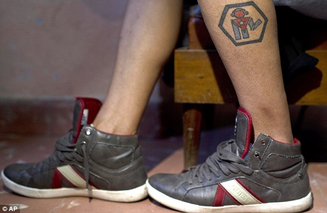 Barbosa shows AP a tattoo of his ìRevolutionî cultural group. Barbosa said he was initially open to collaboration with Murillo and the other foreigners but was never told they were working for the U.S. 'They presented themselves as a non-governmental organization,' Barbosa said
