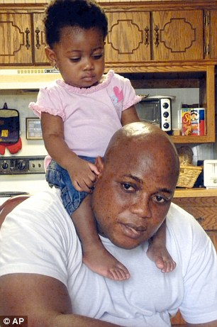 Patrick Sawyer is shown with his daughter Ava at their home in Coon Rapids, Minnesota. He died from Ebola after traveling from his native Liberia to Nigeria