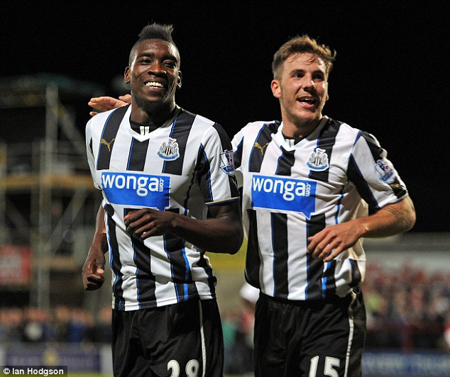 Change: Ameobi (left) wants to switch his international allegiance from England to Nigeria