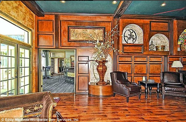 Warm and welcoming: One sitting room sports wooden floors and walls and comfortable leather seats
