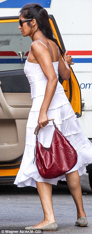 Simple style: The mother-of-one displayed her slender frame in the fitted dress, which she paired with black-and-white striped ballet flats and a red leather handbag