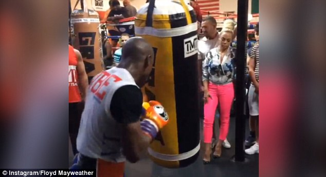 Undefeated: Bo0xing champion Mayweather works out with girlfriend Doralie Medina watching on