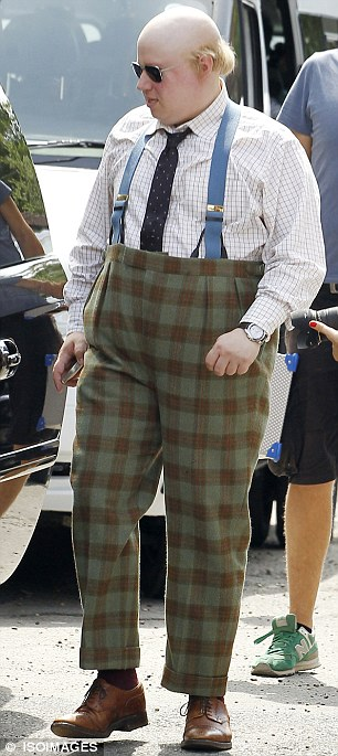 In character: The British actor was dressed in a high-waisted pair of patterned trousers, complete with braces, a spotted tie and checked shirt